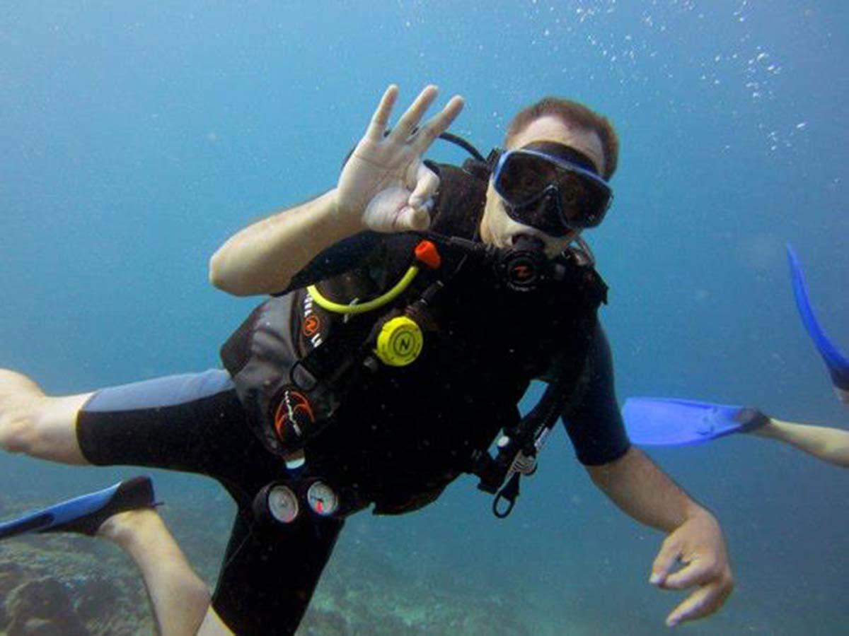 The OK sign you use when you learn to scuba dive in Thailand photo credit to Emmy Ahlen